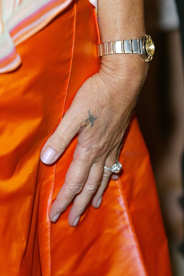 """LONDON - SEPTEMBER 2:  (UK PAPERS OUT) A close up of a tattoo on the hand of Helen Mirren at the UK gala premiere of """"Calendar Girls"""" at the Odeon, Leicester Square on September 2, 2003 in London, England.  (Photo by Steve Finn/Getty Images)"""