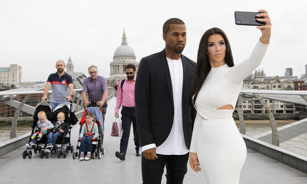 LONDON, UNITED KINGDOM - AUGUST 05: Kanye West and Kim Kardashian's 'selfie taking' wax figures seen at Millenium Bridge on August 05, 2015 in London, England. PHOTOGRAPH BY Jonathan Hordle / Barcroft Media (Photo credit should read Jonathan Hordle / Barcroft Media via Getty Images)